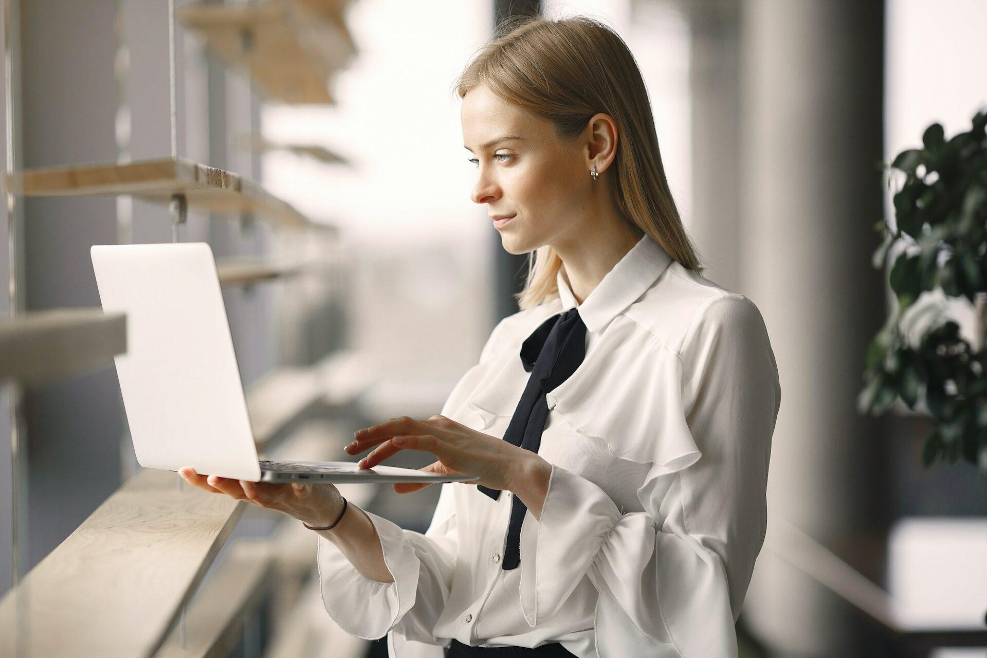 https://www.shiwaforce.com/wp-content/uploads/2020/06/focused-worker-using-laptop-in-office-lobby-4173263-1.jpg
